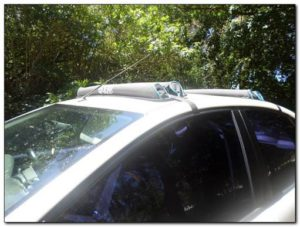 gear roof rack car racking system paddle kayak fishing rod front angle view